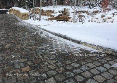 52-Antique Granite Cobblestone 5x5x2 and reclaimed limestone curb