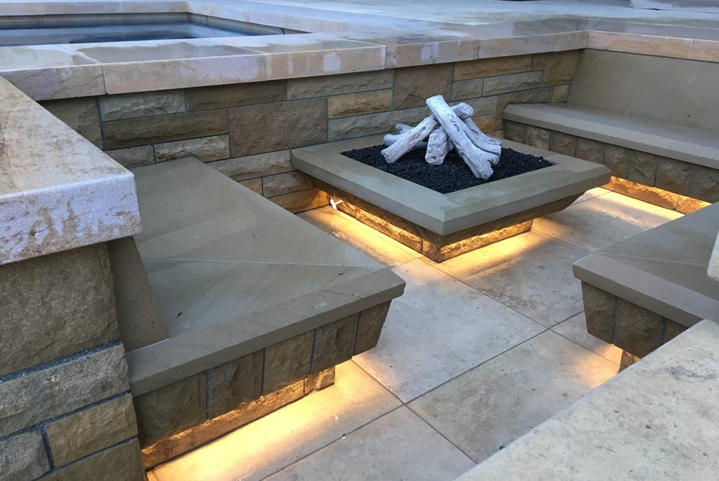 Santa Barbara Sandstone Warms Backyard Fire and Entertainment Area